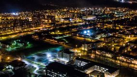 Hyperlapse timelapse of night city traffic on streets. Aerial view. Amazing aerial timelapse footage. Night city with traffic. Cars, roads, buildings stock footage