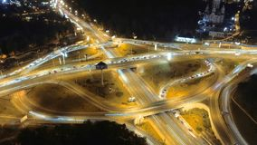 Hyperlapse timelapse of night city traffic. Vertical aerial view. stock video