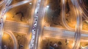 Hyperlapse timelapse of night city traffic. Vertical aerial view. stock footage