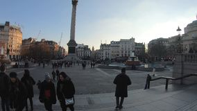 Hyperlapse in Trafalgar square with crowd of tourists and artists, London, United Kingdom. London, United Kingdom - January 2019: Hyperlapse in Trafalgar square stock video