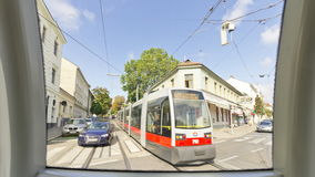 Hyperlapse tramway ride in Vienna. Time-lapse out of a moving streetcar line number 40 in Vienna, Austria. The tram stops at the stations stock video