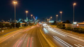 Hyperlapse video of highway traffic and cityscape