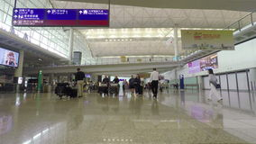 Hyperlapse video of travellers in the departure hall of Hong Kong International Airport. Hong Kong, China - June 23, 2015: Hyperlapse video of travellers in the stock footage
