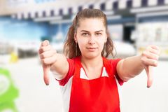 Hypermarket employee showing thumbs-down royalty free stock image