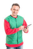 Hypermarket employee using wireless tablet Stock Image