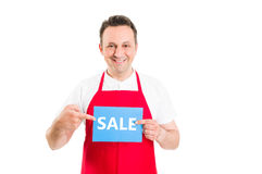 Hypermarket employee or worker holding sale sign Royalty Free Stock Images