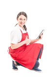 Hypermarket female worker showing thumb up Stock Images