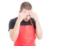 Hypermarket seller having headache Stock Image