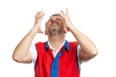 Hypermarket worker with headache making despaired expression stock image