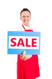 Hypermarket worker holding SALE sign Stock Photography
