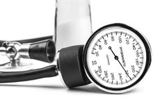 Hypertension. Black thethoscope and sphygmamanometer with salt in the background isolated on white Stock Photos