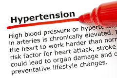 Hypertension underlined with red marker. The word Hypertension underlined with red marker on white paper Stock Images