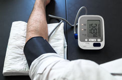 Hypertensive patient performing a blood pressure auto test Royalty Free Stock Photos