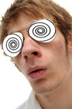 Hypnosis. Man with black and white spirals in his aviator glasses being hypnotized stock images