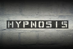 Hypnosis WORD GR. Hypnosis stencil print on the grunge white brick wall stock photography