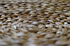Hypnotic effect of rattan texture. Close up of brown rattan texture with selective focus Stock Photos