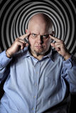 Hypnotic gaze. Man with hypnotic gaze and deep focused expression. Mind control concept Stock Images