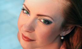 Hypnotic Green. Beautiful woman with hypnotic green eyes Stock Photo