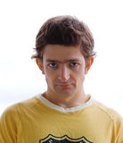 Hypnotising sight. Steadfastly looking young man in a yellow T-shirt Royalty Free Stock Images