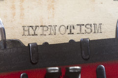 Hypnotism. Typed in an old vintage paper macro shot Royalty Free Stock Photos