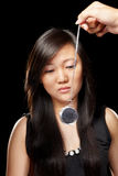 Hypnotize. Young Chinese lady being hypnotized with pendulum Stock Images