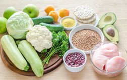 Hypoallergenic diet: products of different groups. On the wooden table royalty free stock photos