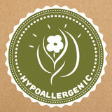 Hypoallergenic green label, badge with leaves and flower for allergy safe products, isolated  object.  Royalty Free Stock Image