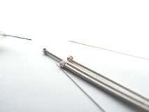 Hypodermic acupuncture needles. This is a shot of three needle heads and two tips used for acupuncture. the stems are about 1 mm thick with the heads 1.5mm thick stock image