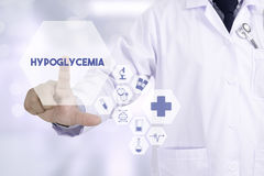 Hypoglycemia Professional doctor use computer and medical equipm Stock Photography