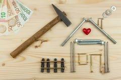 Hypothèque pour construire une maison pour la famille Vrai argent pour construire une maison L'argent de prêt pour le logement Co images libres de droits