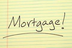 Hypothek! auf einem gelben Kanzleibogenblock Stockfoto