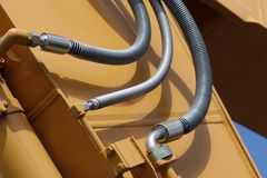 Hyrdaulic lines. Hydraulic lines on a front shovel royalty free stock photos