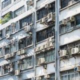 Hyreshus i Hong Kong abstrakt bakgrundsstad Royaltyfri Foto