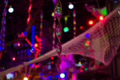 Hysteria of sails restaraunt. Lights. Sails net, diffrent lights and motley decoration stock images