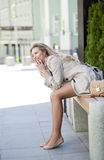 Hysterical laughter, laughing young beautiful girl sitting on th Stock Photo