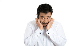 A hysterical man very anxious having a negative feeling about something Stock Photos