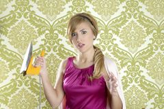 Hysterical retro woman vintage iron wallpaper Royalty Free Stock Photo