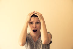 Hysterical woman Stock Images