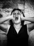 Hysterical woman screaming Royalty Free Stock Images