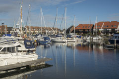 Hythe Marina, Hampshire, UK. Houses by the river with reflections at Riverside Park, Southampton, Hampshire, UK Royalty Free Stock Photos