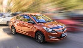 Hyundai är en orange bil Royaltyfria Bilder
