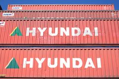 Hyundai 40 ft intermodal containers stacked in harbor. royalty free stock photos
