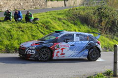 Hyundai i20 competitive engaged during the 64th rally of Sanremo. Peugeot 208 Competitive engaged during the 64th rally of Sanremo conducted in the race crew Royalty Free Stock Photo