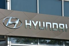 Hyundai logotype on a building. Vilnius, Lithuania - May 16: Hyundai logotype on a building on May 16, 2018 in Vilnius Lithuania. Hyundai is a South Korean Stock Photos