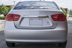 Hyundai rear end. Picture of silver hyundai rear and with licence plate and red taillights Stock Photo
