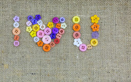 I❤U, I love you synonym made from colorful buttons. On old vintage fax canvas top view royalty free stock images