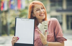 I achieved the success for which I fought. Business woman with money on street royalty free stock images