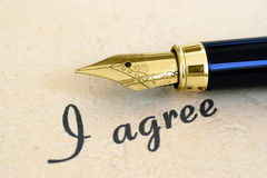I agree. Text and fountain pen Royalty Free Stock Images