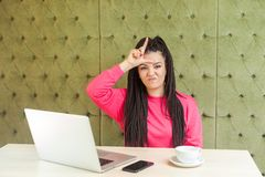 Free I Am Loser! Negative Rude Young Girl With Black Dreadlocks Hairstyle In Pink Blouse Are Sitting In Cafe And Having Bad Mood Are Stock Photo - 159228020