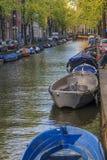I Amsterdam afton Arkivfoto